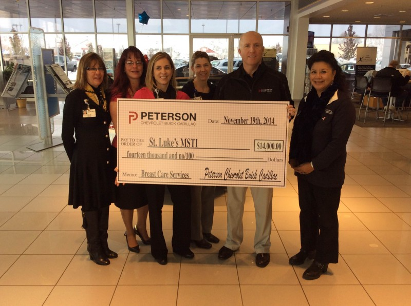 Mark Peterson Presents Check to the St. Lukes and MSTI team.